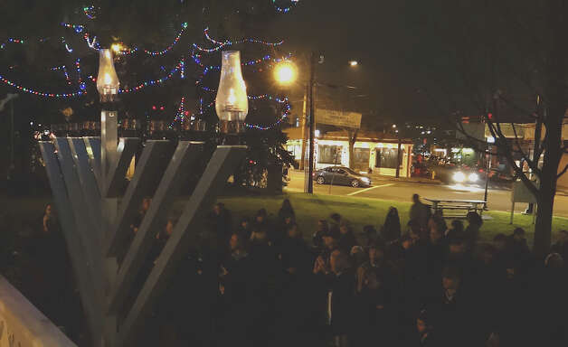 A 9-foot-tall menorah was lighted Saturday night on Sherman Green amid ceremonies organized by Chabad of Fairfield to mark the start of Hanukkah.  Fairfield CT 12/8/12 Photo: Mike Lauterborn / Fairfield Citizen contributed