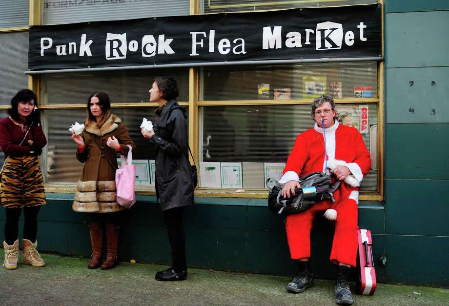 A lone Santa hangs out during SantaCon 2012.  Photo: LINDSEY WASSON, Lindsey Wasson / SEATTLEPI.COM