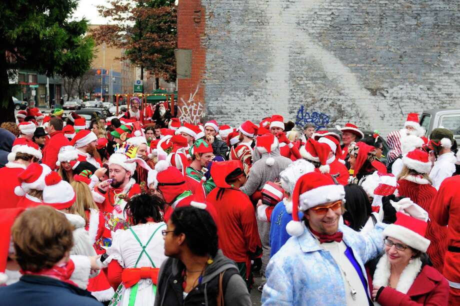 SantaCon began at noon at Seattle Center and wove throughout Belltown,  Capitol Hill, Westlake and Pacific Place, finally ending around 2 a.m.  downtown. Photo: LINDSEY WASSON, Lindsey Wasson / SEATTLEPI.COM