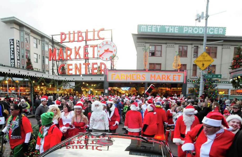 Santas invade Pike Place Market during SantaCon 2012 in Seattle on Saturday, December 8, 2012.  Photo: LINDSEY WASSON, Lindsey Wasson / SEATTLEPI.COM