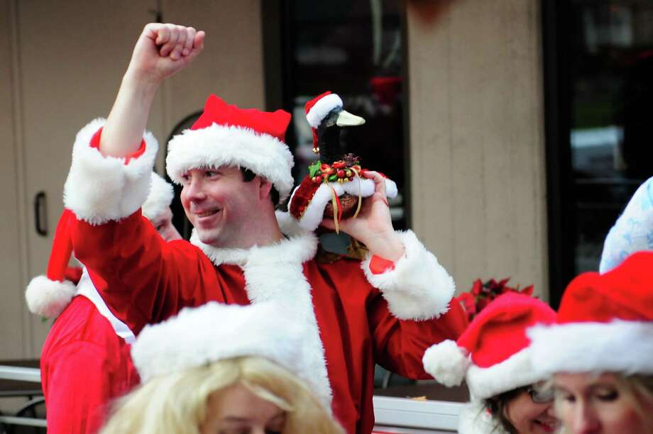 "Clay Gustaves walks with his ""Duck of Christmas Present"" during SantaCon 2012 in Seattle on Saturday, December 8, 2012.  Photo: LINDSEY WASSON, Lindsey Wasson / SEATTLEPI.COM"