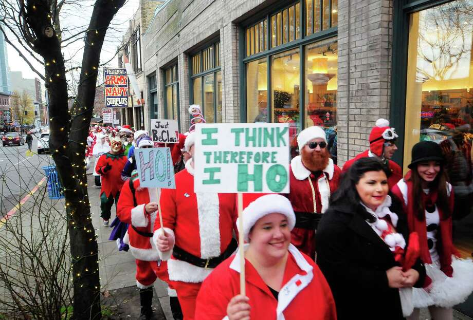 SantaCon participants march through the streets during SantaCon 2012 in Seattle on Saturday, December 8, 2012. Photo: LINDSEY WASSON, Lindsey Wasson / SEATTLEPI.COM
