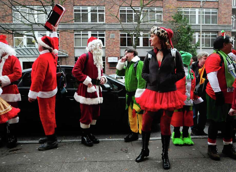 Santas gather near the Belltown Pub during SantaCon 2012 in Seattle on Saturday, December 8, 2012. Photo: LINDSEY WASSON, Lindsey Wasson / SEATTLEPI.COM