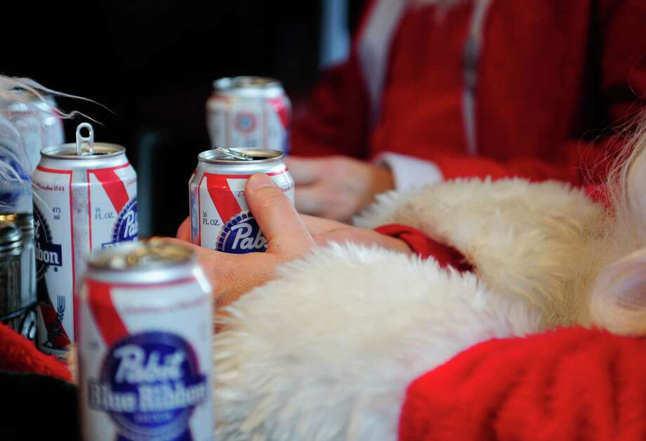 Pabst appears to be the Santa drink of choice at the Sport Restaurant & Bar during SantaCon 2012 in Seattle on Saturday, December 8, 2012.  Photo: LINDSEY WASSON, Lindsey Wasson / SEATTLEPI.COM