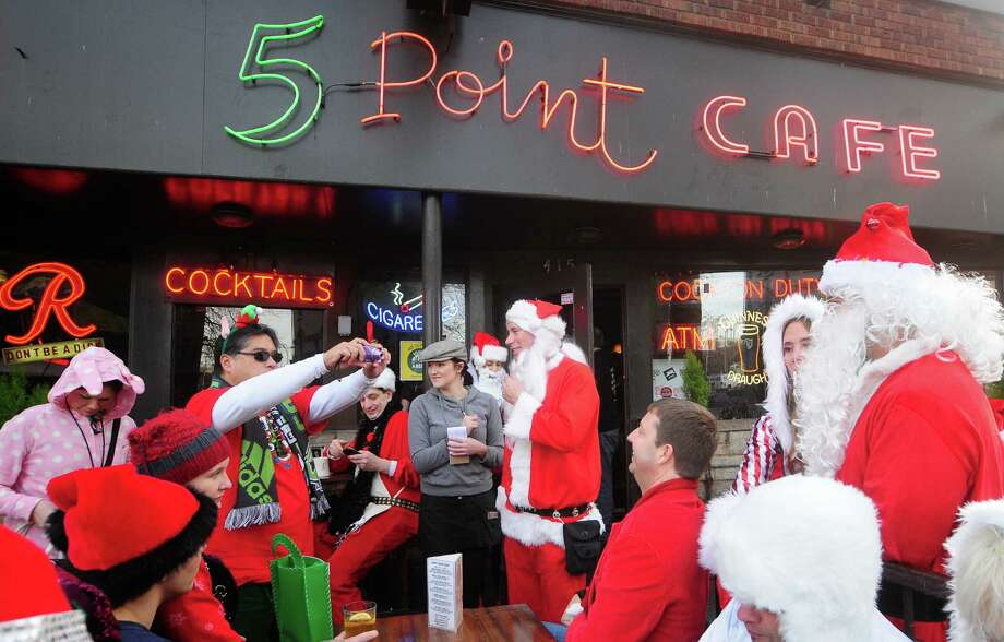SantaCon 2012 stops at The 5 Point Cafe for drinks and snacks in Seattle on Saturday, December 8, 2012.  Photo: LINDSEY WASSON, Lindsey Wasson / SEATTLEPI.COM