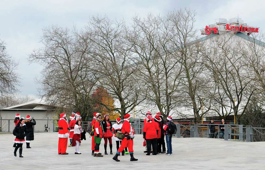 A few Santas begin to gather for SantaCon 2012 at Fisher Pavilion in Seattle on Saturday, December 8, 2012.  Photo: LINDSEY WASSON, Lindsey Wasson / SEATTLEPI.COM