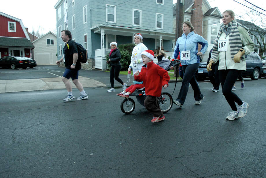The Volvo of Stamford Greenwich Cup series of 10 races wraps up with the three mile Jingle Bell Jog on Church Street in Greenwich, Conn., Dec. 9, 2012. The event was run by Threads and Treads and raised money for Pathways, Inc., a town agency aimed at helping people who suffer from chronic mental illness. Photo: Keelin Daly / Stamford Advocate Riverbend Stamford, CT
