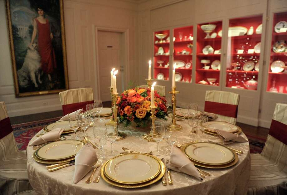 The Truman China is set on a table in the China Room of the White House in Washington, Wednesday, Nov. 28, 2012, during a preview of the holiday decorations. This set was first selected by First lady Bess Truman in 1951 and is the first state china service to feature the Presidential Coat of Arms as redesigned by President Harry Truman in 1945. The theme for the White House Christmas 2012 is Joy to All. (AP Photo/Susan Walsh) (Susan Walsh / AP Photo) Photo: Susan Walsh, Associated Press / AP