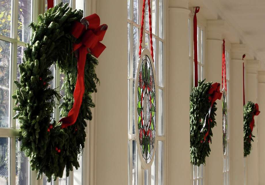 A stained glass window, created by Chicago-based artist David Lee Csicsko, is on display at the East Wing with Christmas wreaths during a preview of the 2012 White House holiday decorations November 28, 2012 at the White House in Washington, DC.  First lady Michelle Obama welcomed military families, including Gold Star and Blue Star parents, spouses and children, to the White House for the first viewing of the 2012 holiday decorations. The theme for the White House Christmas 2012 is Joy to All. Photo: Alex Wong, Getty Images / 2012 Getty Images