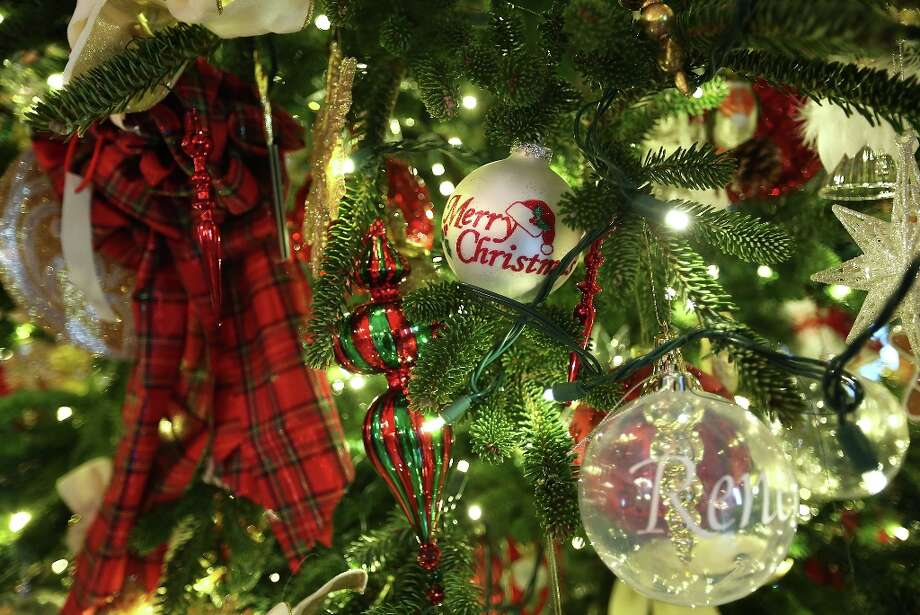 Ornaments on a Christmas tree are seen during a preview of the 2012 White House holiday decorations November 28, 2012 at the White House in Washington, DC.  First lady Michelle Obama welcomed military families, including Gold Star and Blue Star parents, spouses and children, to the White House for the first viewing of the 2012 holiday decorations. The theme for the White House Christmas 2012 is Joy to All. Photo: Alex Wong, Getty Images / 2012 Getty Images