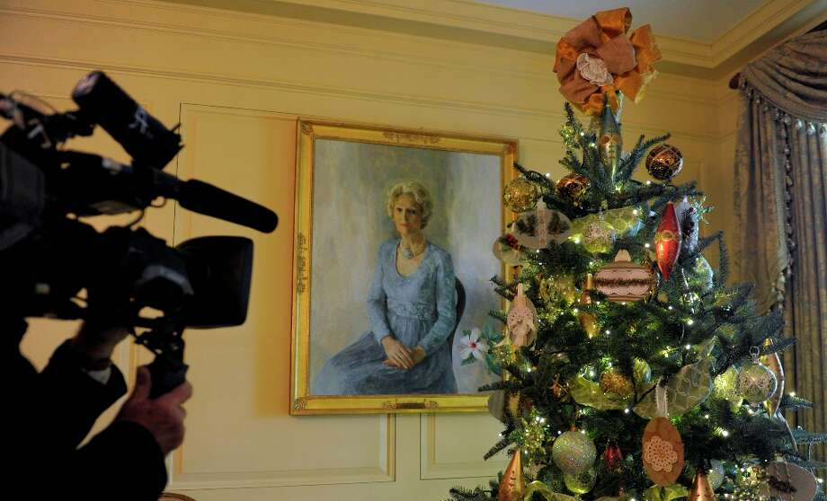 A portrait of former first lady Pat Nixon hangs near a tree in the Vermeil Room of the White House in Washington, Wednesday, Nov. 28, 2012, during a press preview of the White House holiday decorations. The theme for the White House Christmas 2012 is Joy to All.  (Susan Walsh / AP Photo) Photo: Susan Walsh, Associated Press / AP