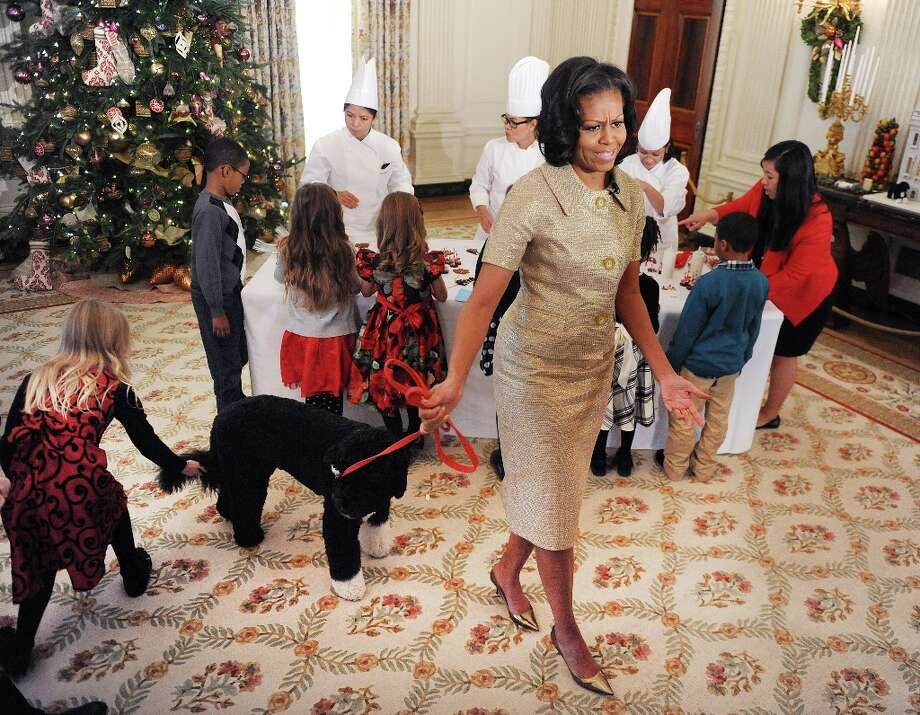 First lady Michelle Obama and family dog Bo attend the preview of the White House Christmas decorations, November 28, 2012, in Washington, D.C. Photo: Olivier Douliery, McClatchy-Tribune News Service / Abaca Press