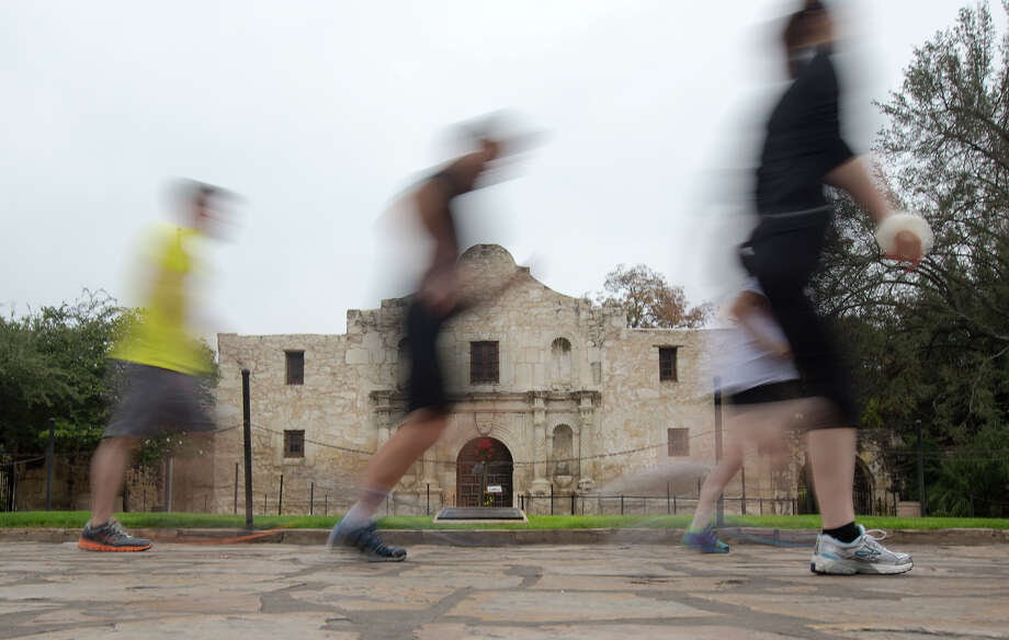 FOR METRO - Runners participate in a River City Run, a 5K course through the heart of downtown with informative stops at historic locations along the way, at the Alamo on Sunday, Dec. 9, 2012. MICHAEL MILLER / FOR THE EXPRESS-NEWS Photo: Michael Miller, For The Express-News  / © San Antonio Express-News