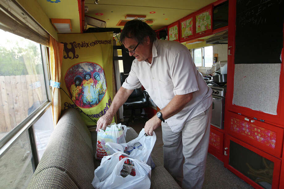 Carrizo Springs Junior High School special education teacher Jef Kerrigan, 54, (cq), settles in for the evening in his motorhome parked at a RV park in Carrizo Springs, Texas, Tuesday, Dec. 4, 2012. New hires by the Carrizo Springs Consolidated Independent School District and other districts in the Eagle Ford Shale play are warned of the housing shortage and high rents. Kerrigan is in his first year with the district. Photo: Jerry Lara, San Antonio Express-News / © 2012 San Antonio Express-News