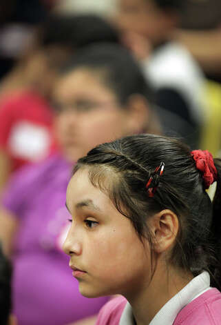 Herminia Travieso listens to Maudie Magallon, of United Communities of San Antonio, during an anti-bullying, anti-bigotry workshop for 5th graders at Candlewood Elementary. Friday, Dec. 7, 2012. Photo: Bob Owen, San Antonio Express-News / © 2012 San Antonio Express-News