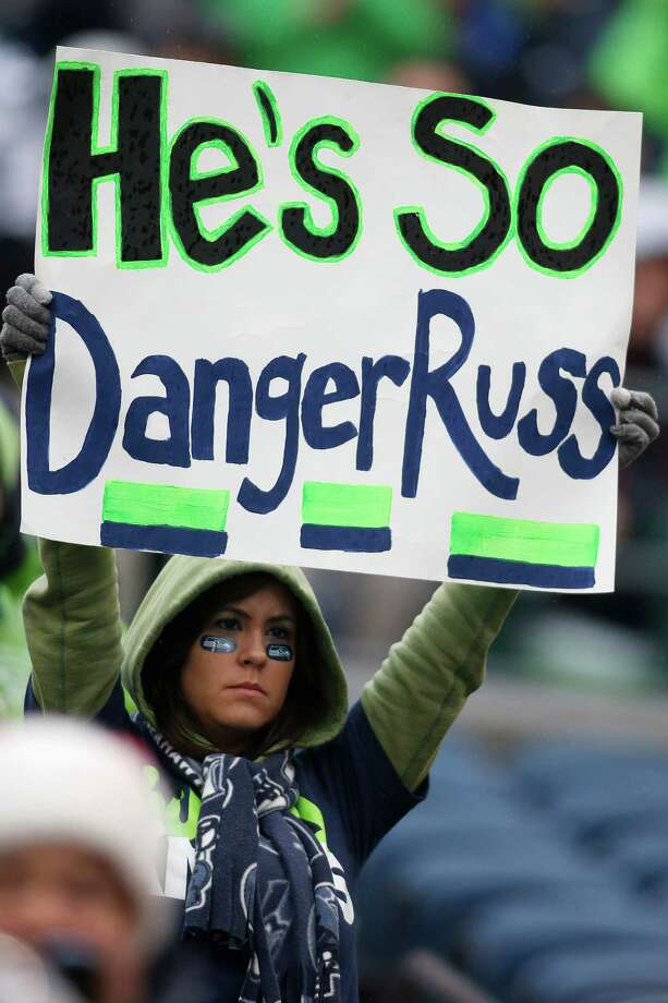 A Seattle Seahawks fan holds up a sign for quarterback Russell Wilson before an NFL football game between the Seattle Seahawks and the Arizona Cardinals in Seattle, Sunday, Dec. 9, 2012. Photo: AP