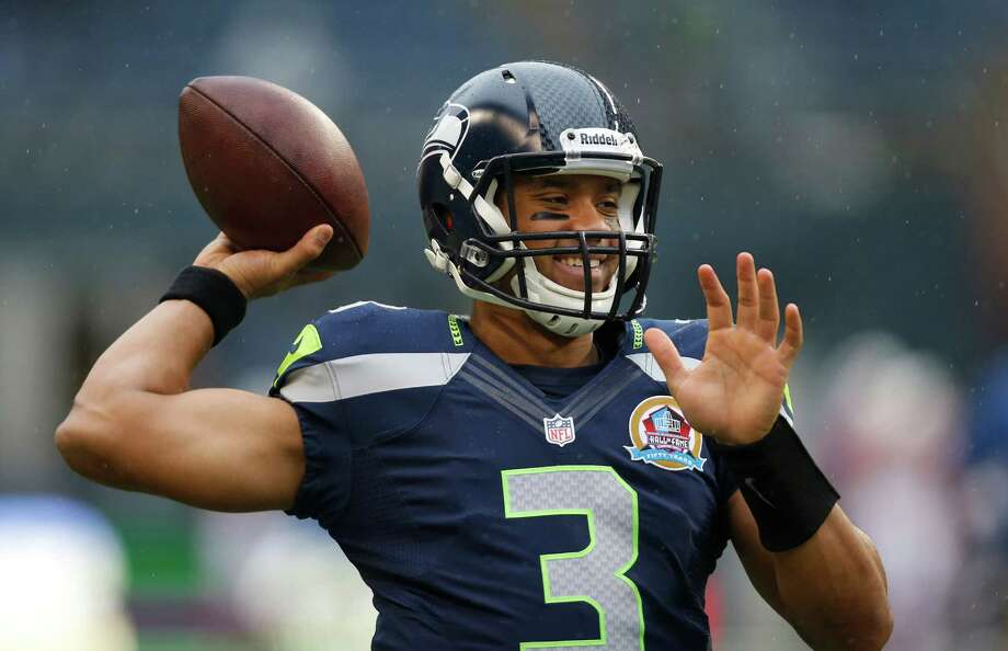 Seattle Seahawks quarterback Russell Wilson (3) warms up before an NFL football game against the Arizona Cardinals in Seattle, Sunday, Dec. 9, 2012. Photo: AP