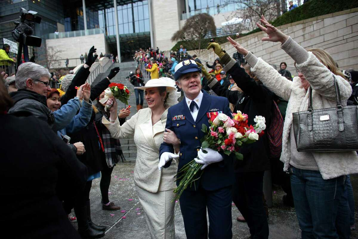 Deb Needham, left, and Nancy Monahan, a retired member of the U.S. Coast Guard, walk down the stairs of Seattle City Hall after they were married on Sunday, December 9, 2012, the first day same-sex couples in Washington State can legally be married.