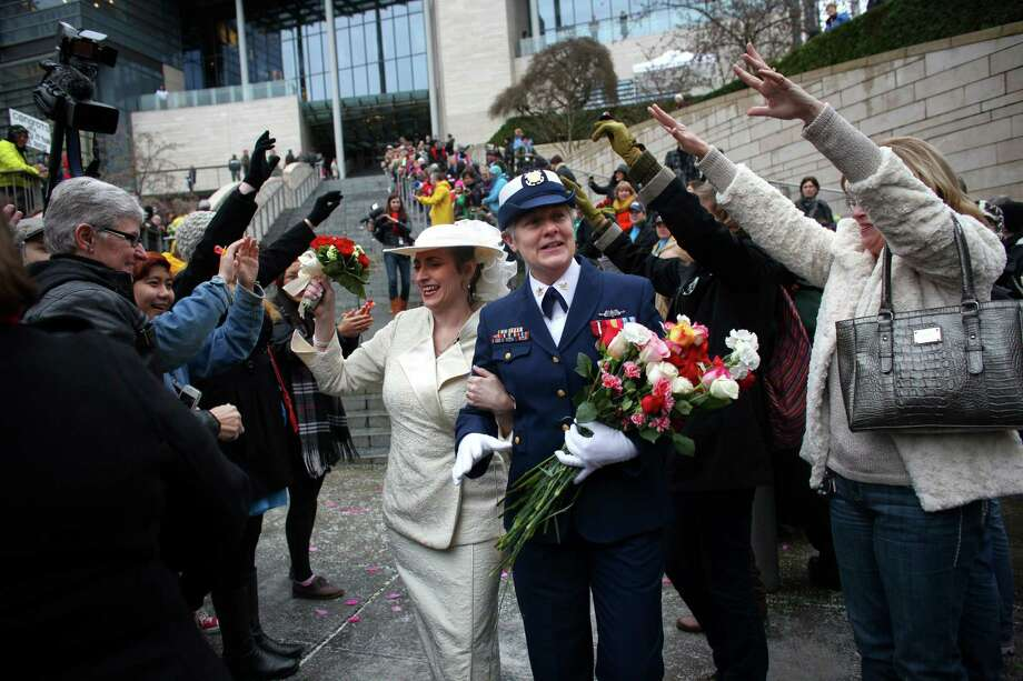 Deb Needham, left, and Nancy Monahan, a retired member of the U.S. Coast Guard, walk down the stairs of Seattle City Hall after they were married on Sunday, December 9, 2012, the first day same-sex couples in Washington State can legally be married. Photo: JOSHUA TRUJILLO / SEATTLEPI.COM