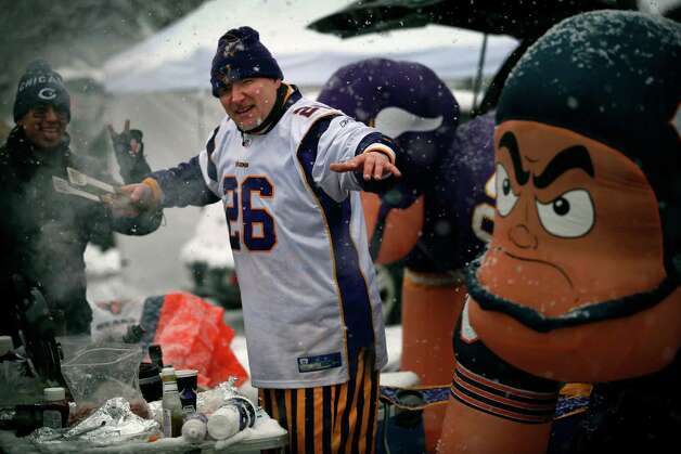 Minnesota Vikings fan Joseph Russo, of Chicago, tailgates before an NFL football game between the Chicago Bears and the Vikings, Sunday, Dec. 9, 2012, in Minneapolis. A major winter storm was expected to dump 9 to 15 inches across a broad belt of central Minnesota including the Twin Cities area by Sunday night, and the storm was also to bring heavy snow to parts of western Wisconsin. (AP Photo/The Star Tribune, Jerry Holt)  MANDATORY CREDIT; ST. PAUL PIONEER PRESS OUT; MAGS OUT; TWIN CITIES TV OUT Photo: Jerry Holt, Associated Press / The Star Tribune