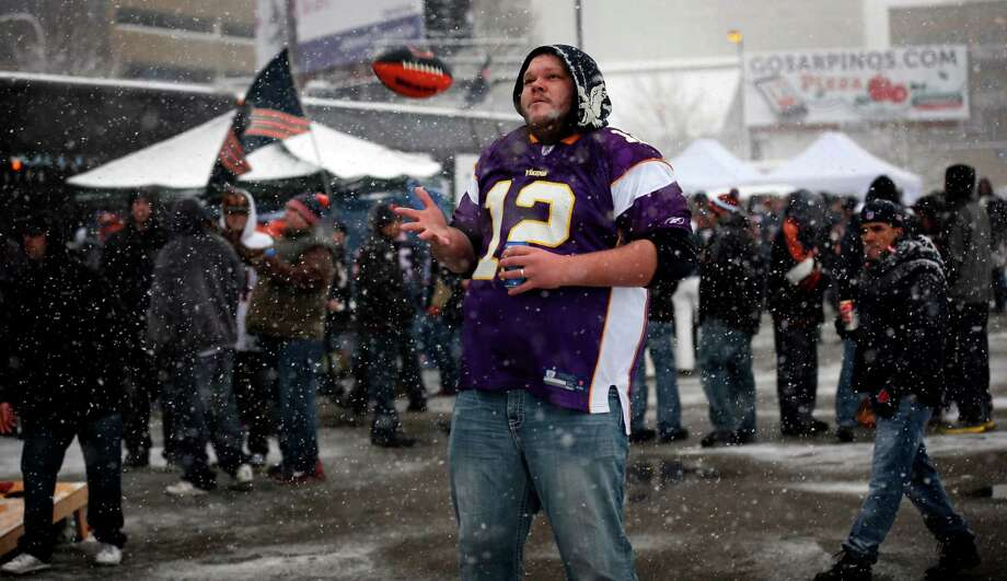 Ken Tracy, of Buffalo, Minn., enjoys the snow as he tailgates before an NFL football game with the Chicago Bears and the Minnesota Vikings, Sunday, Dec. 9, 2012, in Minneapolis. (AP Photo/The Star Tribune, Jerry Holt) MANDATORY CREDIT; ST. PAUL PIONEER PRESS OUT; MAGS OUT; TWIN CITIES TV OUT. Photo: Jerry Holt, Associated Press / The Star Tribune