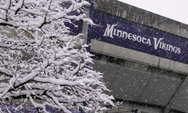 Snow covered trees are seen outside the Mall of America Field at the Hubert H. Humphrey Metrodome before an NFL football game between the Minnesota Vikings and the Chicago Bears, Sunday, Dec. 9, 2012, in Minneapolis. (AP Photo/Andy King) Photo: Andy King, Associated Press / FR51399 AP