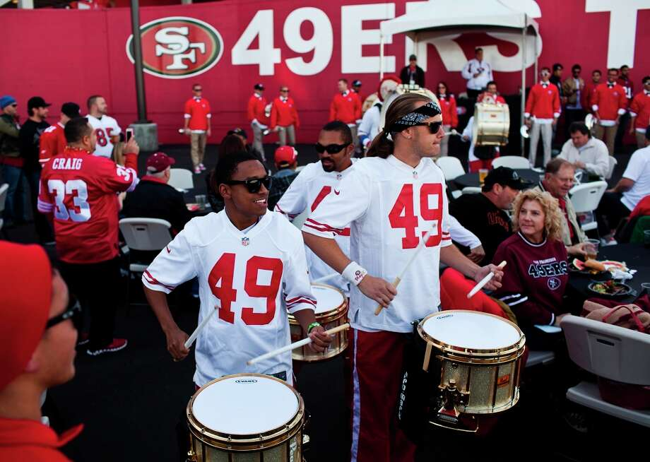 Most of the members of Niner Noise are from, or have been through, the  world champion Blue Devils Drum and Bugle Corps based in Concord, CA and have been with the Niner Noise since its inception in 2007. Here Keelan Tobia and The Niner Noise perform for fans in the VIP area. Photo: Jason Henry, Special To The Chronicle / ONLINE_YES
