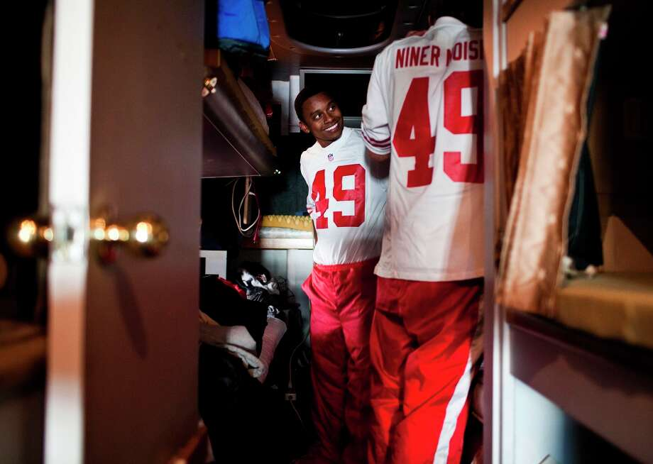 Keelan Tobia, of The Niner Noise, puts on his uniform on the bus before performing for fans tailgating around Candlestick Park in San Francisco, Calif., Sunday, November 11, 2012. Photo: Jason Henry, Special To The Chronicle / ONLINE_YES