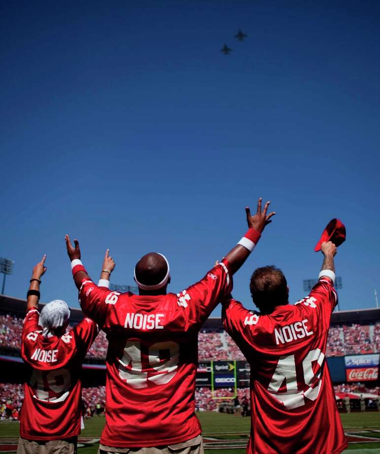 Members of the Niner Noise Drumline waves at a pair of F-18 fighters during the pre-game ceremony between the San Francisco 49ers and visiting Seattle Seahawks at Candlestick Park in San Francisco on Sunday in 2009. Photo: Stephen Lam, The Chronicle / SFC