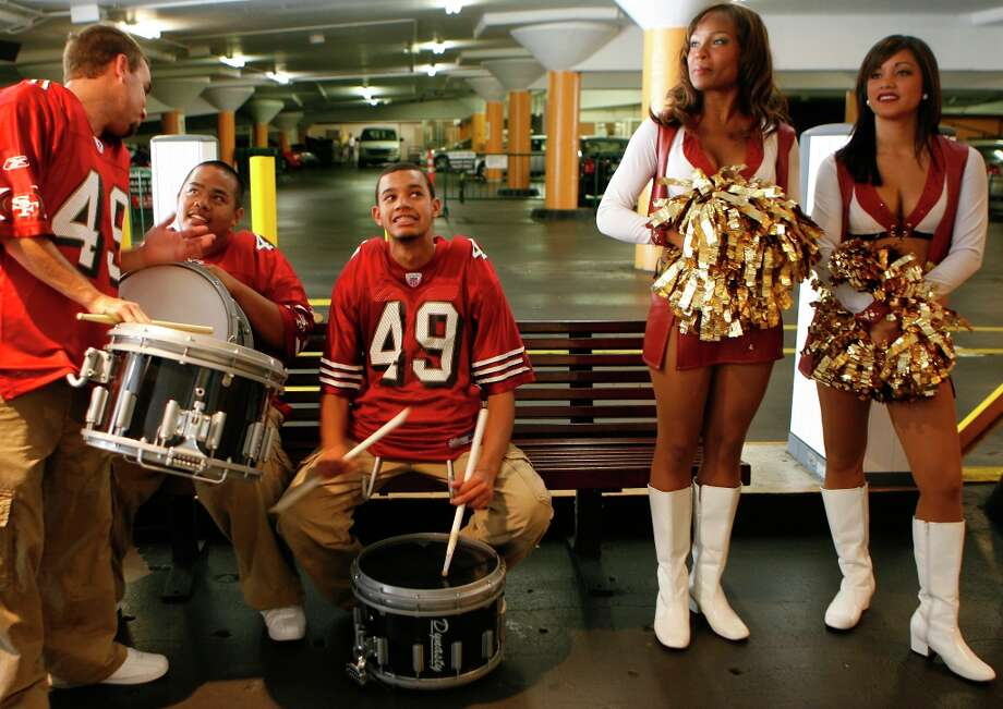 In this striking file photo, players, cheerleaders and Niner Noise drummers show up in different locations around the city for the 49ers' Countdown to Kickoff in 2006. (Deanne Fitzmaurice / The Chronicle) Photo: Deanne Fitzmaurice, SFC / San Francisco Chronicle