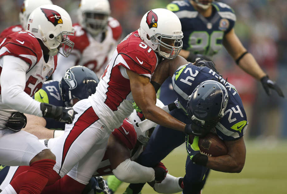 Arizona Cardinals inside linebacker Paris Lenon (51) tackles Seattle Seahawks running back Marshawn Lynch (24) during the first quarter of an NFL football game in Seattle, Sunday, Dec. 9, 2012. Photo: AP