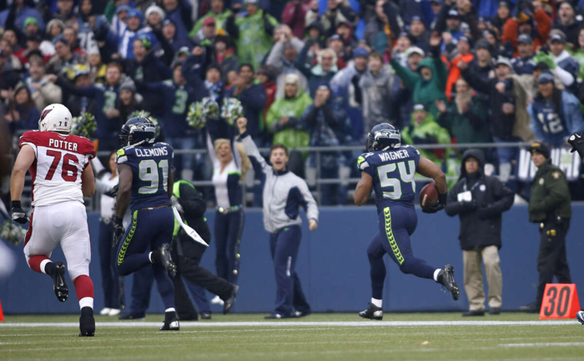 Seattle Seahawks middle linebacker Bobby Wagner (54) returns an interception from Arizona Cardinals quarterback John Skelton during the first quarter of an NFL football game in Seattle, Sunday, Dec. 9, 2012.