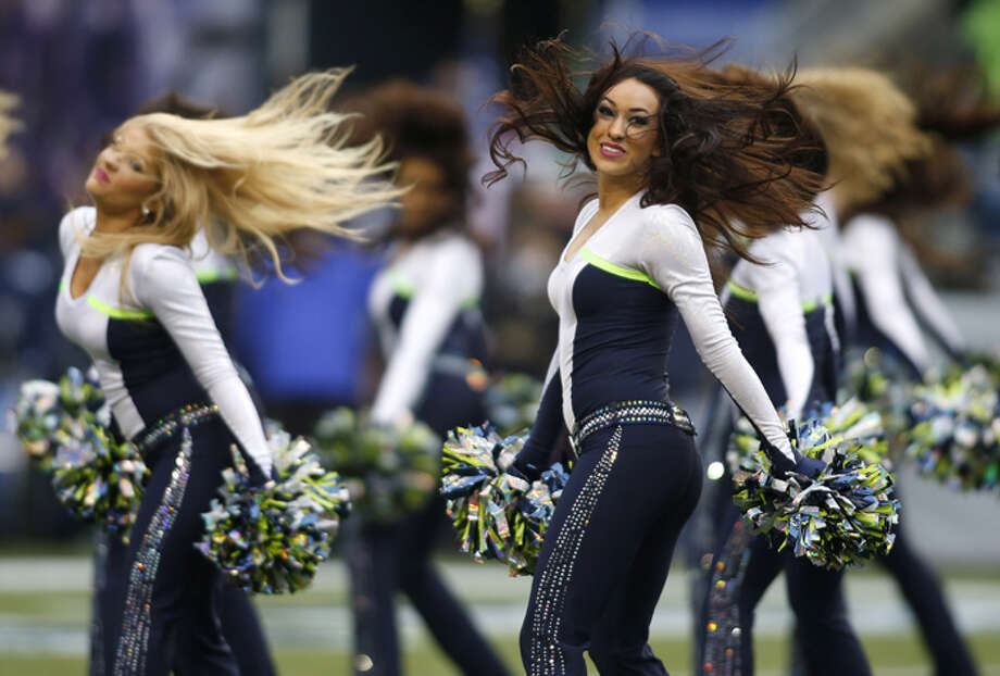 Seattle Seahawks cheerleaders perform before an NFL football game between the Seattle Seahawks and the Arizona Cardinals in Seattle, Sunday, Dec. 9, 2012. Photo: AP