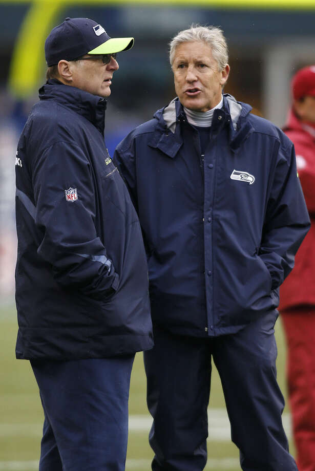 Seattle Seahawks owner Paul Allen, left, talks with Pete Carroll before an NFL football game against the Arizona Cardinals in Seattle, Sunday, Dec. 9, 2012. Photo: AP
