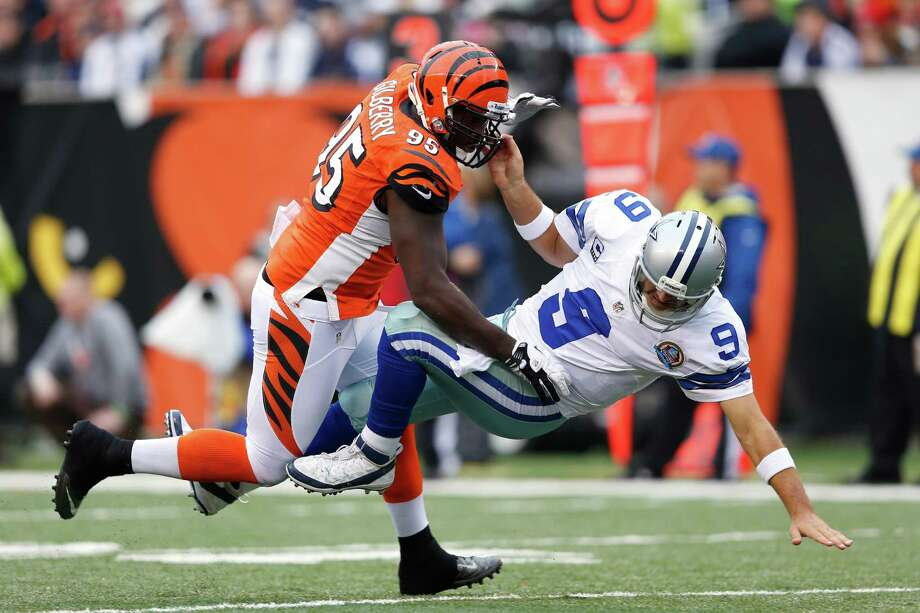 Wallace Gilberry #95 of the Cincinnati Bengals knocks down Tony Romo #9 of the Dallas Cowboys during the game at Paul Brown Stadium on December 9, 2012 in Cincinnati, Ohio. Photo: Joe Robbins, Getty Images / 2012 Getty Images