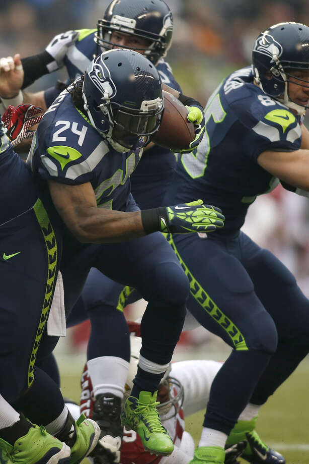 Seattle Seahawks running back Marshawn Lynch (24) runs against the Arizona Cardinals during the first quarter of an NFL football game in Seattle, Sunday, Dec. 9, 2012. Photo: AP