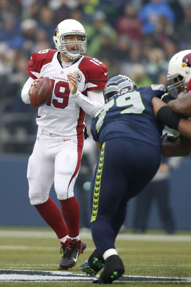 Arizona Cardinals quarterback John Skelton (19) passes as Seattle Seahawks defensive end Red Bryant (79) applies pressure during the first quarter of an NFL football game in Seattle, Sunday, Dec. 9, 2012. Photo: AP