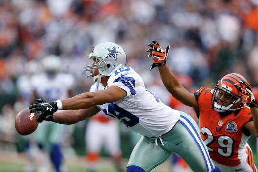 Miles Austin #19 of the Dallas Cowboys drops a pass ahead of Leon Hall #29 of the Cincinnati Bengals during the game at Paul Brown Stadium on December 9, 2012 in Cincinnati, Ohio. Photo: Joe Robbins, Getty Images / 2012 Getty Images
