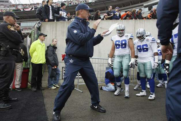 Head coach Jason Garrett of the Dallas Cowboys leads his team on to the field for the game against the Cincinnati Bengals at Paul Brown Stadium on December 9, 2012 in Cincinnati, Ohio. Photo: John Grieshop, Getty Images / 2012 Getty Images