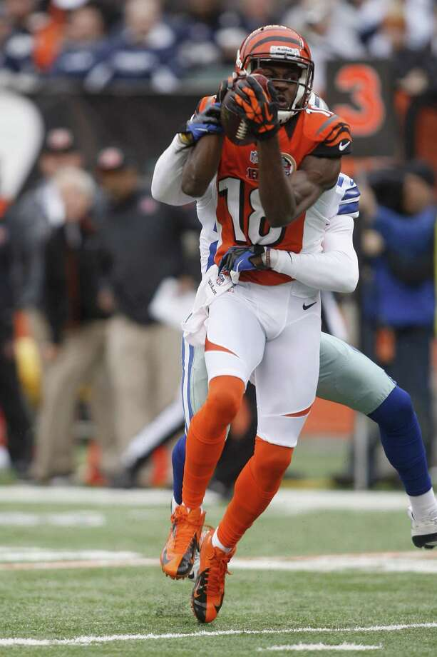 A.J. Green #18 of the Cincinnati Bengals runs the ball upfield during the game against the Dallas Cowboys at Paul Brown Stadium on December 9, 2012 in Cincinnati, Ohio. Photo: John Grieshop, Getty Images / 2012 Getty Images