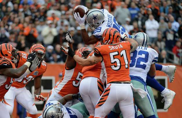 Dallas Cowboys running back DeMarco Murray (29) dives over the goal line for a one yard touchdown in the first half of an NFL football game against the Cincinnati Bengals, Sunday, Dec. 9, 2012, in Cincinnati. (AP Photo/Michael Keating) Photo: Michael Keating, Associated Press / FR170759 AP