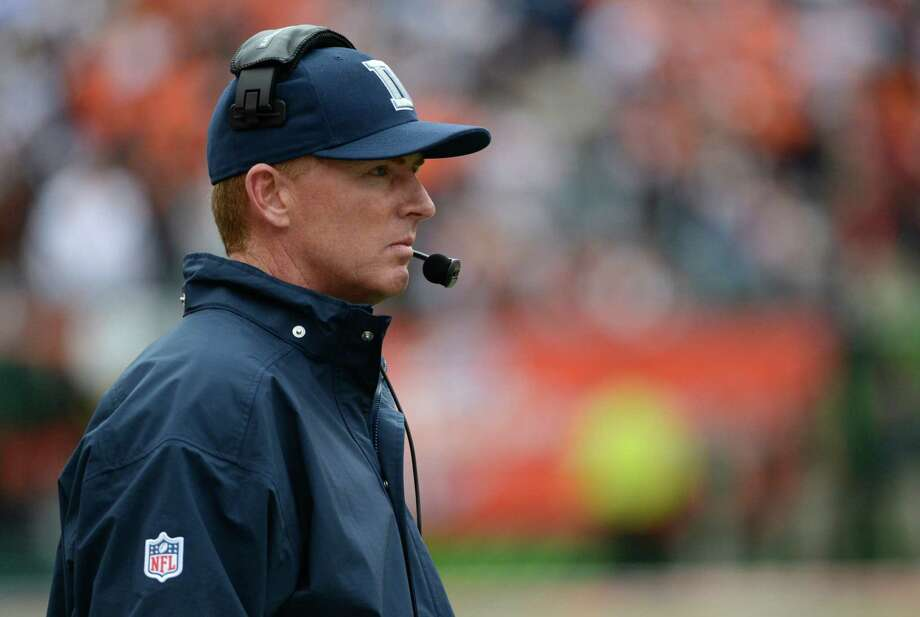Dallas Cowboys head coach Jason Garrett watches in the first half of an NFL football game against the Cincinnati Bengals, Sunday, Dec. 9, 2012, in Cincinnati. (AP Photo/Michael Keating) Photo: Michael Keating, Associated Press / FR170759 AP