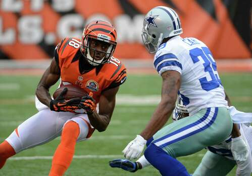 Cincinnati Bengals wide receiver A.J. Green (18) runs against the Dallas Cowboys in the first half of an NFL football game, Sunday, Dec. 9, 2012, in Cincinnati. (AP Photo/Michael Keating) Photo: Michael Keating, Associated Press / FR170759 AP