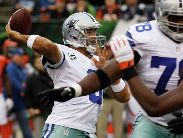 Dallas Cowboys quarterback Tony Romo (9) passes against the Cincinnati Bengals in the first half of an NFL football game, Sunday, Dec. 9, 2012, in Cincinnati. (AP Photo/Tom Uhlman) Photo: Tom Uhlman, Associated Press / FR31154 AP