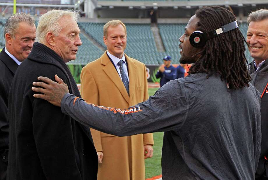 Cincinnati Bengals cornerback Adam Jones, right, talks with Dallas Cowboys owner Jerry Jones, left, prior to an NFL football game against the , Sunday, Dec. 9, 2012, in Cincinnati. (AP Photo/Al Behrman) Photo: Al Behrman, Associated Press / AP