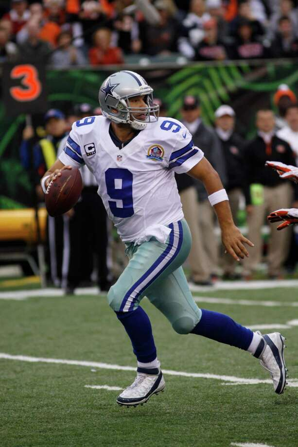 Dallas Cowboys quarterback Tony Romo looks to pass against the Cincinnati Bengals in the second half of an NFL football game, Sunday, Dec. 9, 2012, in Cincinnati. (AP Photo/Tom Uhlman) Photo: Tom Uhlman, Associated Press / FR31154 AP