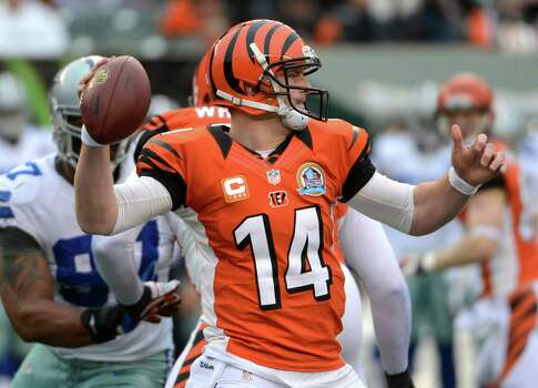 Cincinnati Bengals quarterback Andy Dalton (14) passes against the Dallas Cowboys in the first half of an NFL football game, Sunday, Dec. 9, 2012, in Cincinnati. (AP Photo/Michael Keating) Photo: Michael Keating, Associated Press / FR170759 AP
