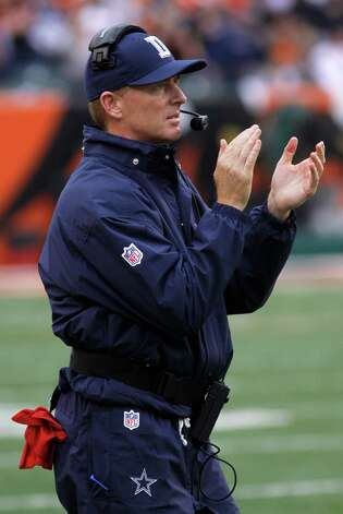 Dallas Cowboys head coach Jason Garrett works on the sidelines in the first half of an NFL football game against the Cincinnati Bengals, Sunday, Dec. 9, 2012, in Cincinnati. (AP Photo/Tom Uhlman) Photo: Tom Uhlman, Associated Press / FR31154 AP