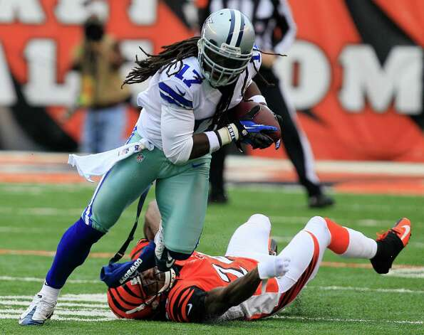 Dallas Cowboys wide receiver Dwayne Harris (17) runs past Cincinnati Bengals cornerback Adam Jones (24) after catching a pass in the first half of an NFL football game, Sunday, Dec. 9, 2012, in Cincinnati. (AP Photo/Al Behrman) Photo: Al Behrman, Associated Press / AP