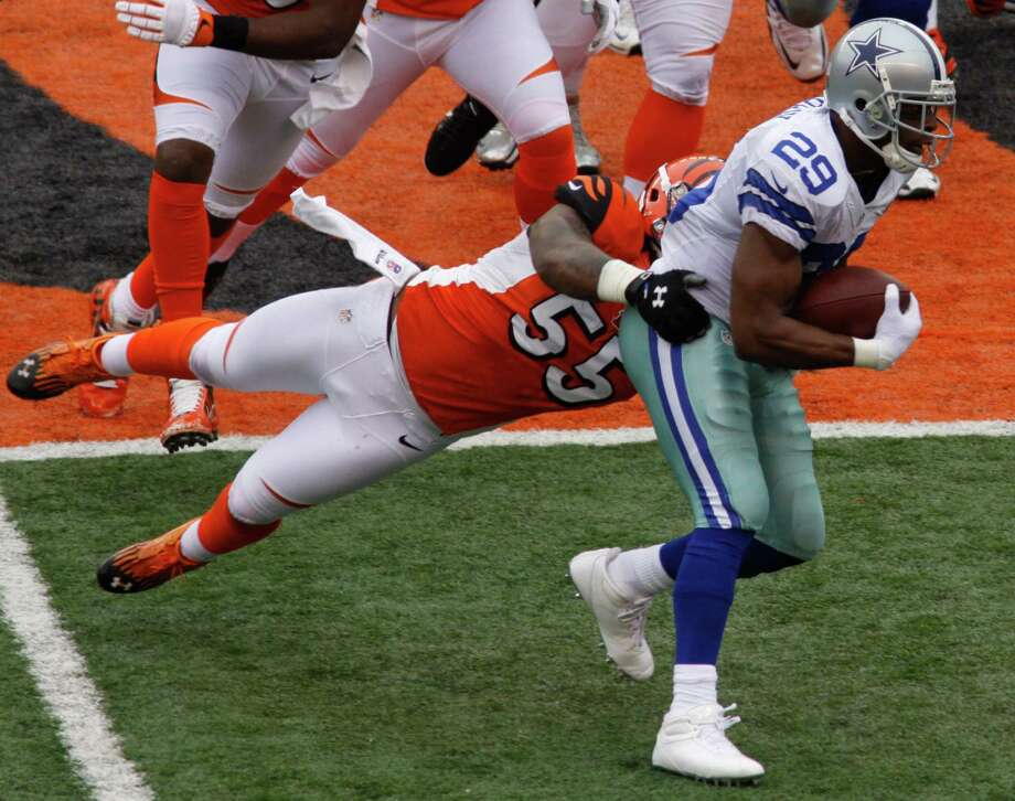 Dallas Cowboys running back DeMarco Murray (29) is tackled by Cincinnati Bengals outside linebacker Vontaze Burfict (55) in the first half of an NFL football game, Sunday, Dec. 9, 2012, in Cincinnati. (AP Photo/Tom Uhlman) Photo: Tom Uhlman, Associated Press / FR31154 AP